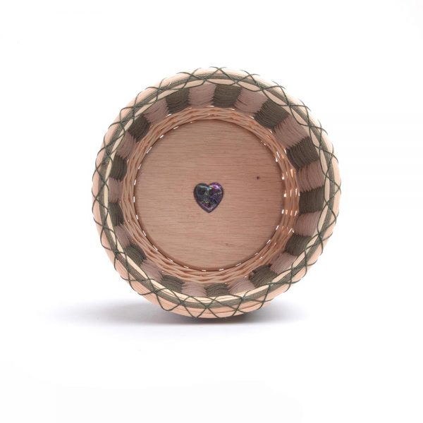 handwoven bowl with little green heart in the bottom
