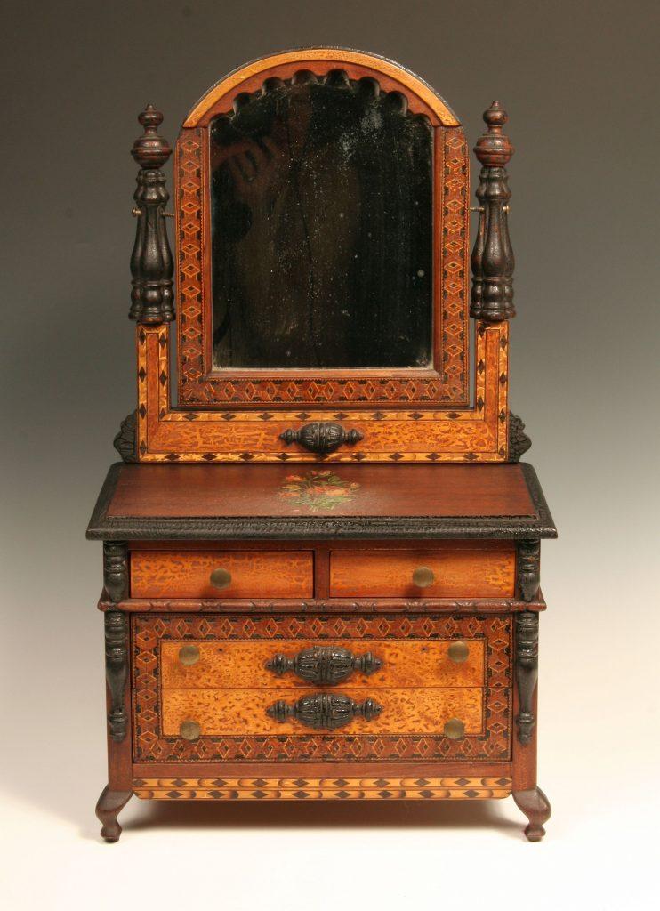 Miniature Bureau with Mirror, c. 1940, four drawer bureau in walnut wood with wood inlay, six brass knobs.