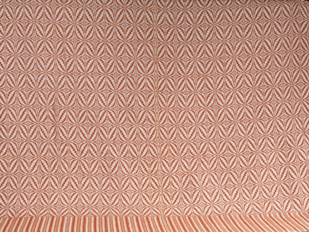 "Blooming Leaf Coverlet, Christopher K. Bobbitt, 1976, overshot coverlet in ""Blooming Leaf"" pattern, natural colored cotton warp and apricot colored wool weft. Narrow plain weave hem."