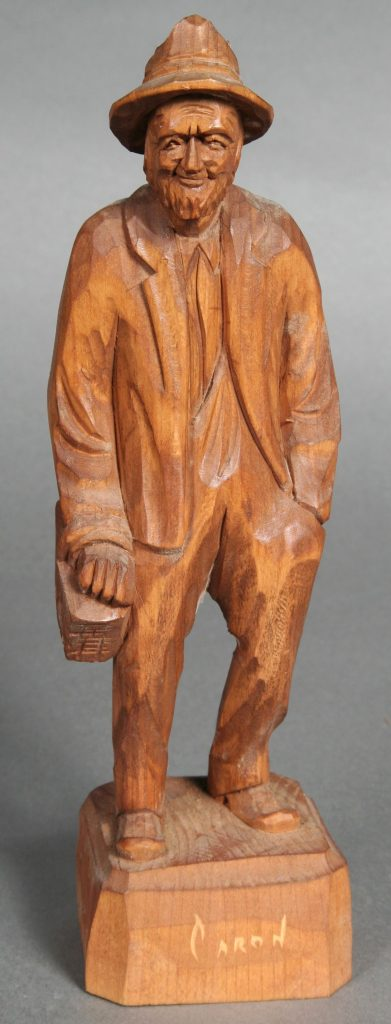 Man with Market Basket, Paul E. Caron, Canadian, c. 1960s, woodcarving of a man carrying a market basket.
