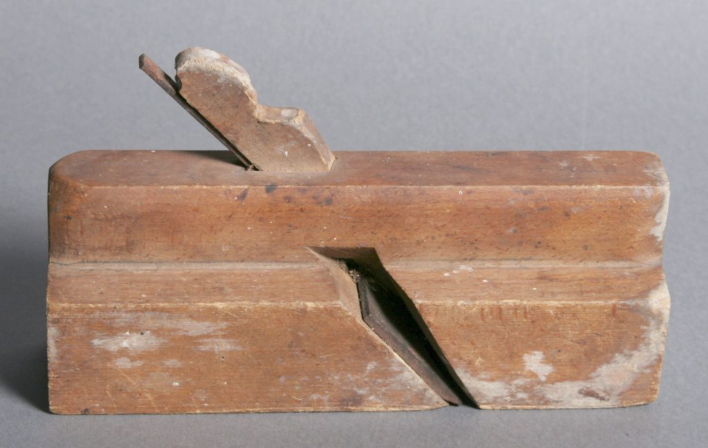 Wood Block Plane, c. 1850, wood - oak plane stepped on the right side. Blade is the widest at the cutting edge and narrow at its top.