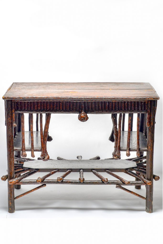 Twig Table, Rev. Benjamin Marcus Davis, c. 1900, rustic wood table with four legs and three ladder-like shevles, two-piece top, one inch thick, all wood dark stained, polished, branches used have a club end.
