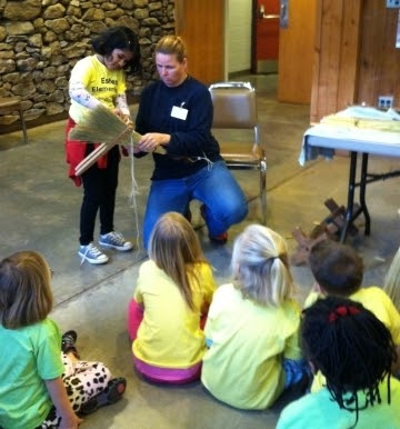 Diana Gates of Friendswood Brooms gives students some hands-on learning about broom making