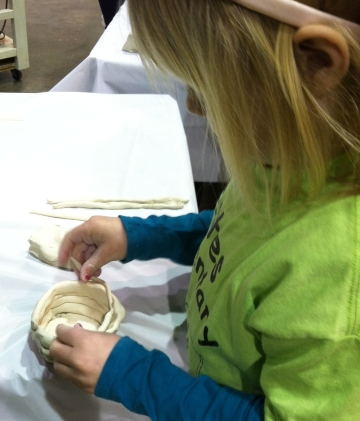 Resident artists from Odyssey Center for Ceramic Arts helped the kids with a coil-built pot.