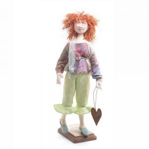 hearts dolls, handmade doll holding a rusty metal heart, red headed handmade cloth doll, john c campbell folk school dollmaker