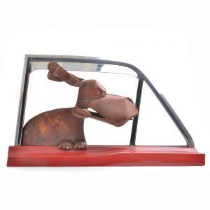 rusty metal dog sculpture, fun wall sculpture, found materials sculpture