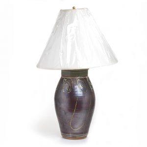dark wheel thrown ceramic lamp with green glaze
