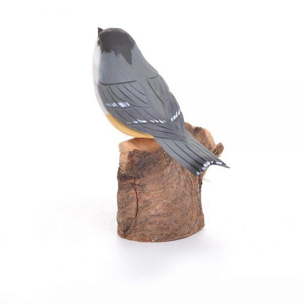 back view of black capped chickadee carving