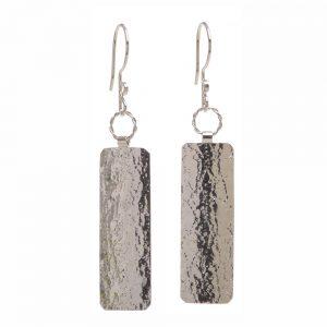 textured silver earrings, shiny plane silver earrings, statement earrings,