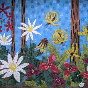 wildflower quilt, colorful handmade quilt, quilt made with hand dyed and silkscreened fabric flowers, colorful floral wall quilt