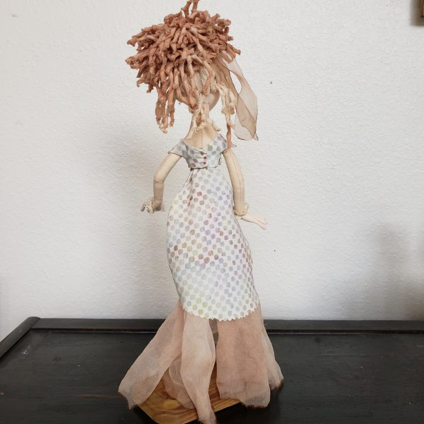 back view of elf fabric doll
