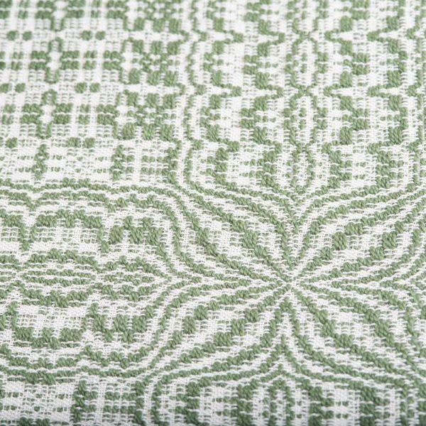 green and white handwoven table runner detail
