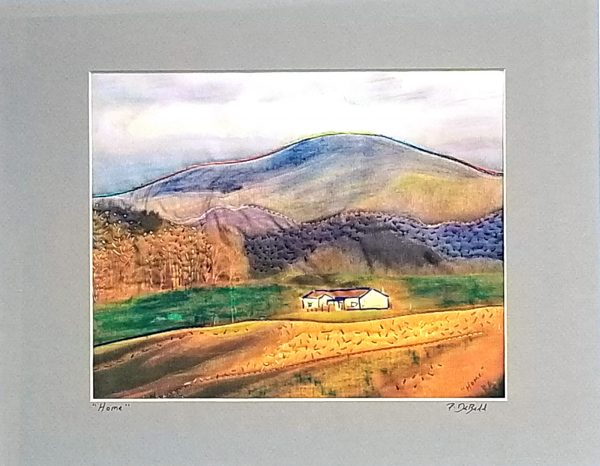 embroidered fall image of a mountain home,