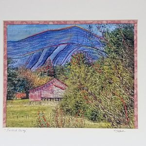 mountain home tucked away behind tree, digitally printed photograph in cotton with hand embroidery and quilting to highlight the details