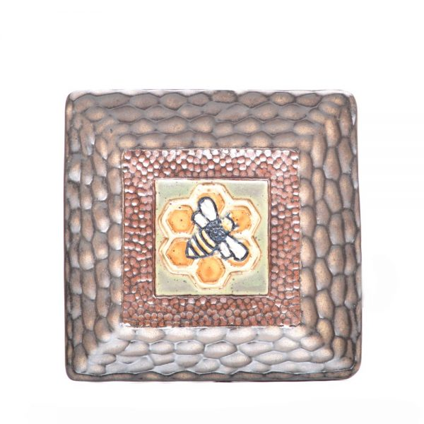 handmade square ceramic plate with carved brown rim and gray center with honeycomb and bee carved