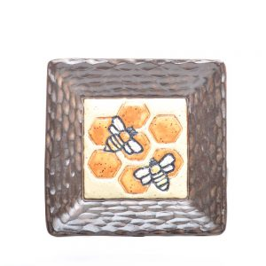 small handmade ceramic bee plate with honeycomb design, carved brown rim