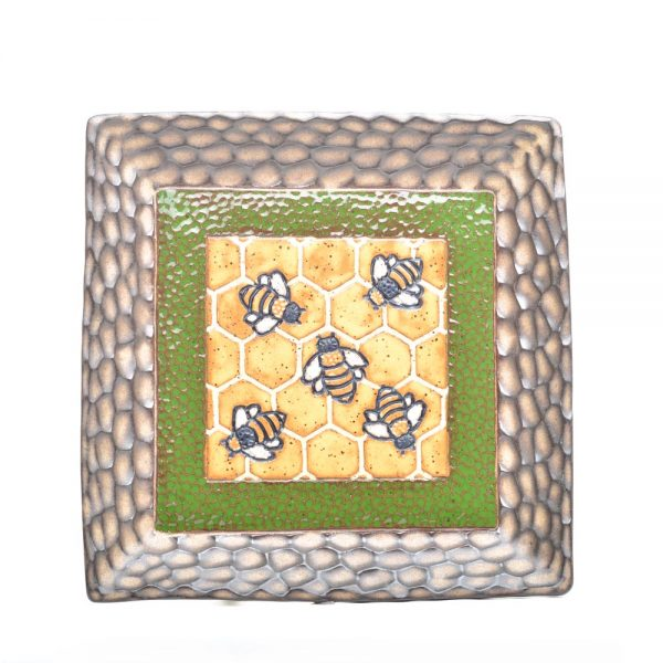 square handmade ceramic plate with brown carved rim green and yellow honeycomb in the middle with carved bees