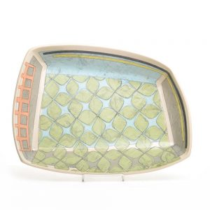 large asymmetrical platter handmade in clay with green gray blue and black