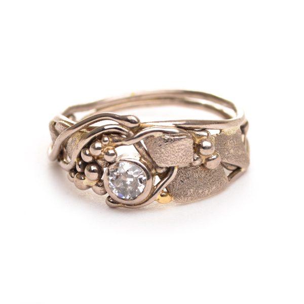asymmetrical gold and diamond ring