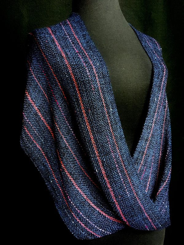 blue and pink handwoven twisted poncho