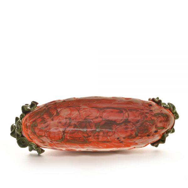 inside view of long scalloped serving dish, orange and white oval serving bowl