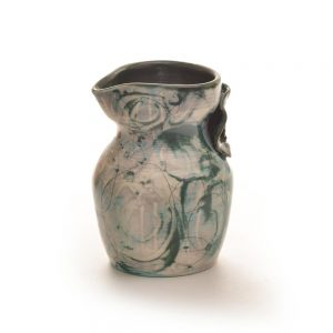blue green ceramic creamer with flower detail