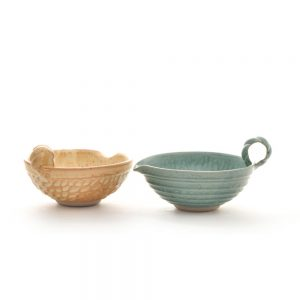wheel thrown handmade small ceramic mixing bowls in cream and turquoise