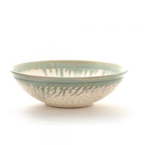 white carved ceramic handmade bowl with drippy light green rim