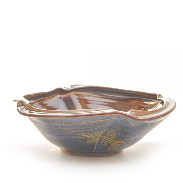 outside view of green glazed altered bowl by sarah wells rolland,