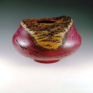 red turned ash bowl with large area of bark