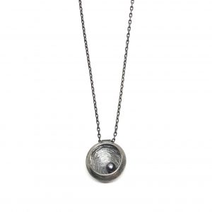 oxidized sterling silver necklace of a nest with an egg