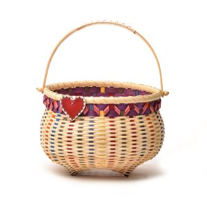 handmade basket with a rainbow of colors, a red heart charm and a nice handle, cat's head basket with heart