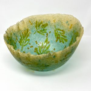 dark turquoise and amber pate de verre vessel with oak leaf design