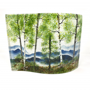 large spring mountain landscape captured in fused glass sheets in an s-curve