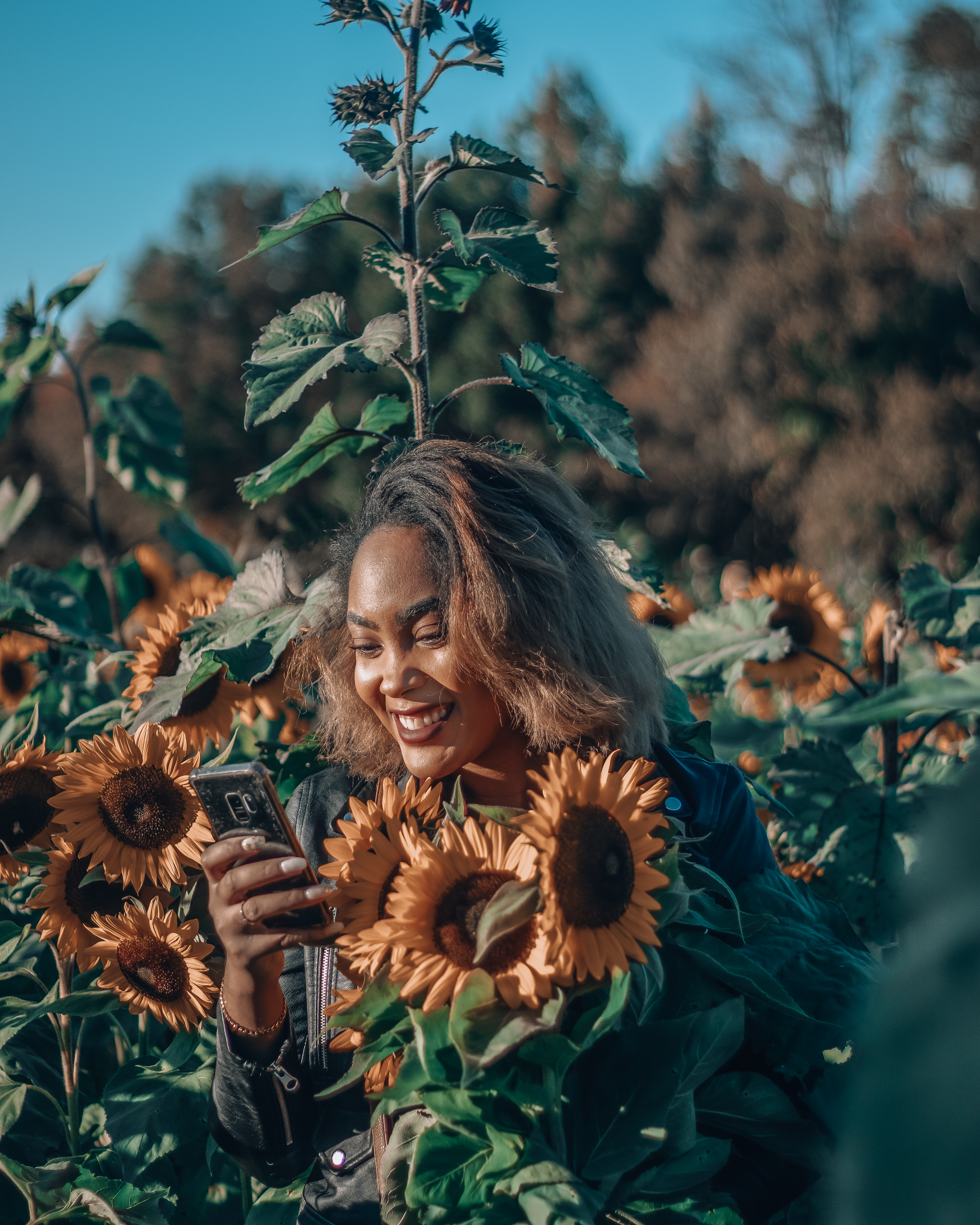Girl smiling with sunflowers
