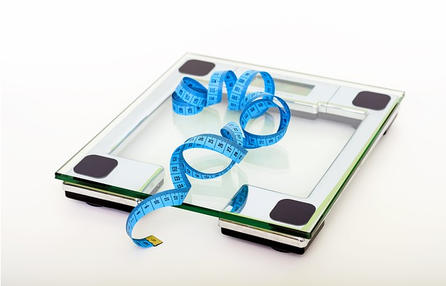 Weight Loss Food: Weighing Scare and Tape Measure to Monitor Weight