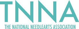 The National NeedleArts Association's Logo