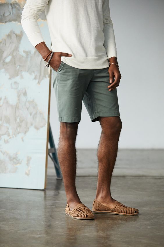 White henley with teal shorts and huarache sandal