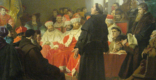 Luther before the Diet of Worms (the trial for heresy) committee.