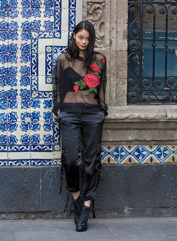 A gotta-be-noticed mesh top with oversized floral appliqué and tied satin pants? Now that's what we call flower power.