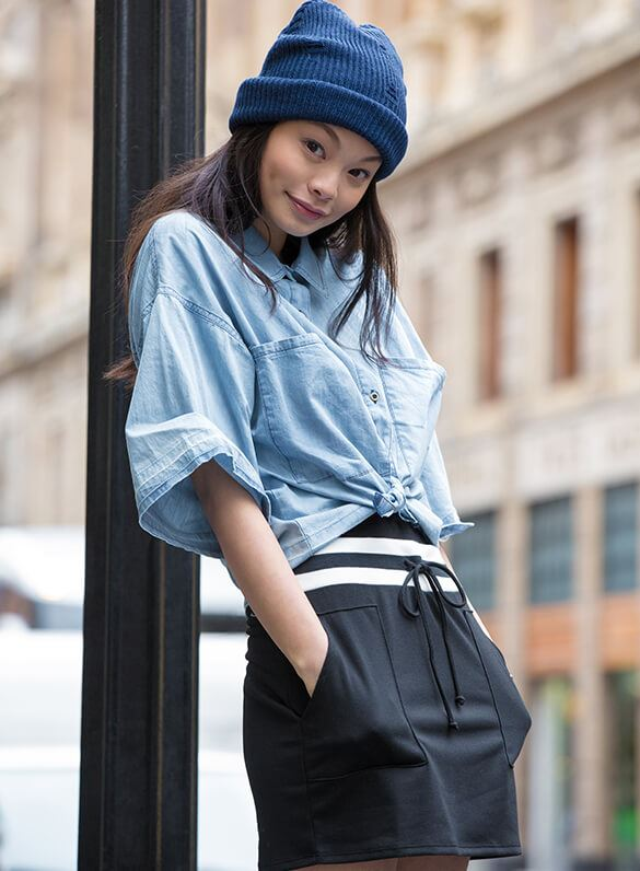 Button up to get down! A soft chambray button-down and varsity-striped skirt are the ultimate outfit win.