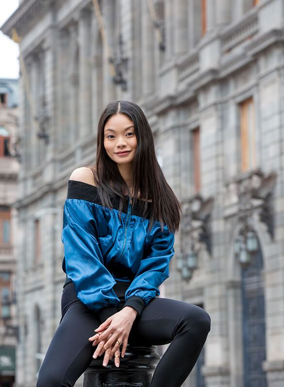 Turquoise satin and an off-the-shoulder silhouette are a totally new take on the classic bomber.