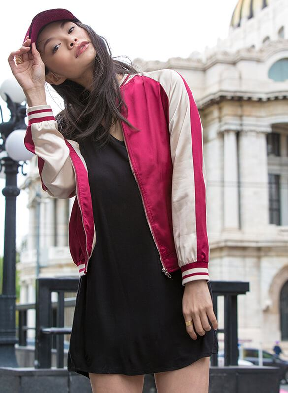 Varsity vibes meet street chic! Take your sporty style straight to the streets in a striped ed satin bomber jacket and a subtly slouchy take on the LBD.