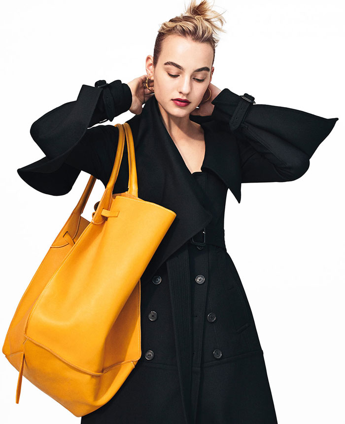 Model with yellow bag