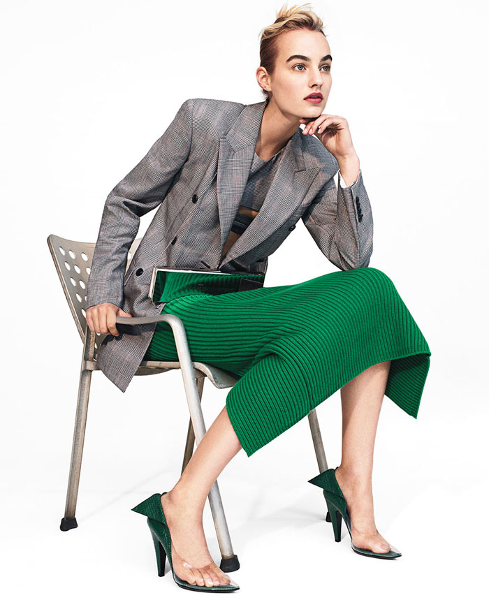 Model green pants in chair