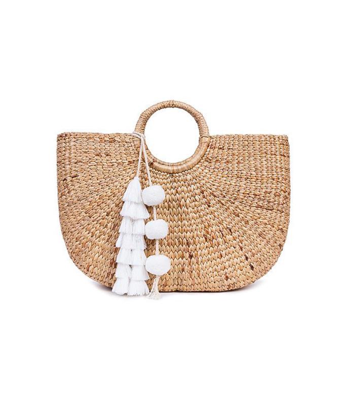 white tasseled basket bag