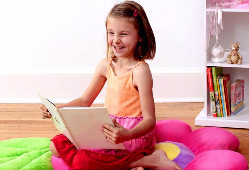 girl reading on floor pillow