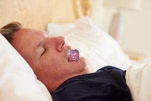 tongue retaining device