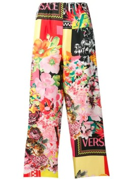 Floral Print Logo Trousers by Versace