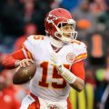 Kansas City Chiefs quarterback Patrick Mahomes (15) drops back to pass in the third quarter against the Denver Broncos at Sports Authority Field at Mile High.